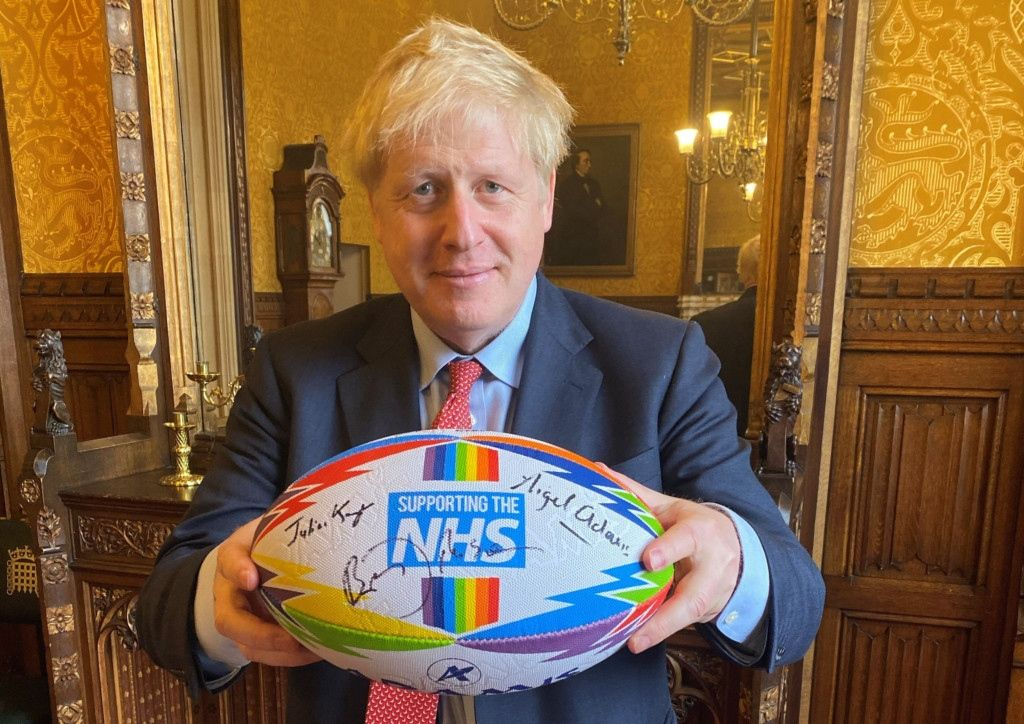 prime minister boris johnson supports aramis rugby with signed aramis rugby ball supporting the nhs