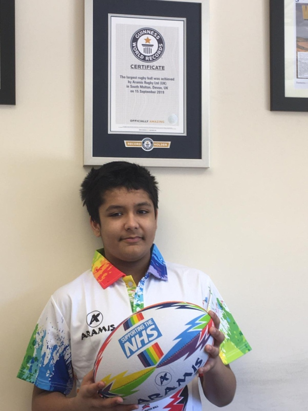 ryan mahajan with the nhs rainbow rugby ball is youngest member of Aramis Rugby