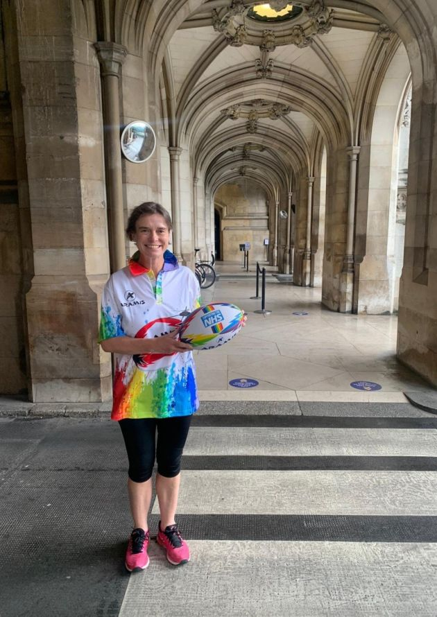 selaine saxby mp for north devon with rainbow themed nhs rugby shirt and nhs rugby ball released by Aramis Rugby