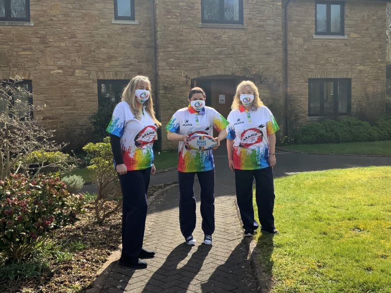 childrens hospice nurses with rugby ball and rugby shirt
