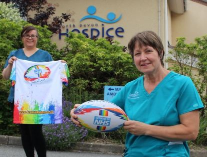 hospice nurses with rugby ball and rugby shirt